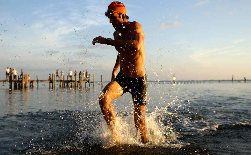 10/01/06---KATHLEEN HINKEL------ Leif Stringer of St. Augustine emerges from the Indian River at Pineapple Park in Melbourne on Sunday during the Health First Olympic Distance Triathlon.  Stringer finished third overall in the event. (Kathleen Hinkel/FLORIDA TODAY)